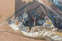 Aerial top view large-scale construction of a residential complex with a view of construction cranes stock images