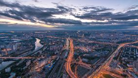 Aerial top view of Moscow city day to night timelapse after sunset. Form from the observation platform of the business stock video footage