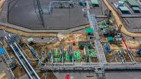 Aerial top view natural gas pipeline, gas industry, gas transport system, stop valves and appliances for gas pumping station.  royalty free stock photo