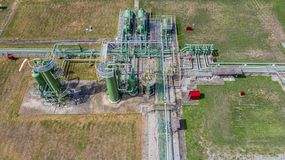 Aerial top view natural gas pipeline, gas industry, gas transport system, stop valves and appliances for gas pumping station.  royalty free stock image