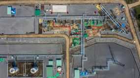 Aerial top view natural gas pipeline, gas industry, gas transport system, stop valves and appliances for gas pumping station.  stock photos