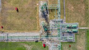 Aerial top view natural gas pipeline, gas industry, gas transport system, stop valves and appliances for gas pumping station.  royalty free stock photography