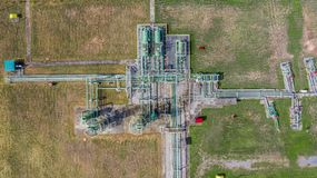 Aerial top view natural gas pipeline, gas industry, gas transport system, stop valves and appliances for gas pumping station.  royalty free stock images