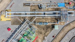Aerial top view natural gas pipeline, gas industry, gas transport system, stop valves and appliances for gas pumping station.  royalty free stock photos
