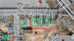 Aerial top view natural gas pipeline, gas industry, gas transport system, stop valves and appliances for gas pumping station.  stock photo