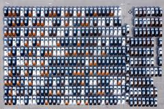 Aerial top view new cars lined up in the port for import export business logistic and transportation by ship in the open sea. New royalty free stock images