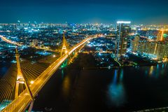 Aerial top view night traffic bridge river side with city royalty free stock image