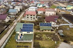 Free Aerial Top View Of Residential House With Team Of Workers Installing Solar Photo Voltaic Panels System On Roof. Renewable Energy Stock Images - 148006024