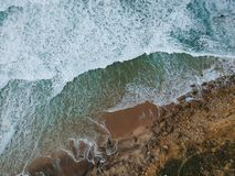 Free Aerial Top View Of Sea Waves Hitting Rocks On The Beach With Turquoise Sea Water. Amazing Rock Cliff Seascape In The Portuguese Co Royalty Free Stock Photography - 132717327