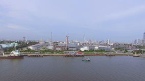 Aerial top view of Oil refinery or factory and container transportation ship on chao phraya river, transportation concept, panning stock video