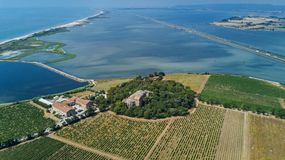 Aerial top view of old church on island from above, canal du Rhone a Sete, Camargue, France. N Stock Images