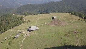 Aerial top view other summer carpathian mountains near by Dzembronya village, Ukraine. View other summer carpathian mountains near by Dzembronya village, Ukraine stock footage