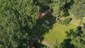 Aerial view of wedding ceremony in park stock video footage