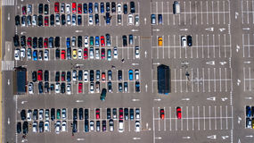 Aerial top view of parking lot with many cars from above, transportation concept. Aerial top view of parking lot with many cars from above, transportation and stock photography
