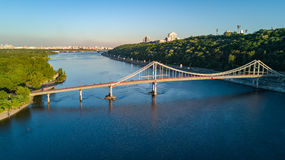 Aerial top view of pedestrian Park bridge and Dnieper river from above, city of Kiev Royalty Free Stock Images