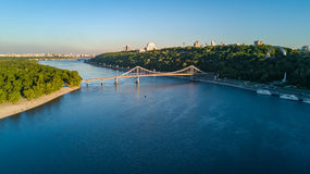 Aerial top view of pedestrian Park bridge and Dnieper river from above, city of Kiev Stock Images