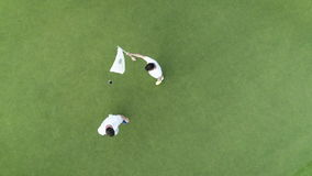 Aerial top view of people playing golf in luxury tropical resort Punta Cana, Dominican Republic