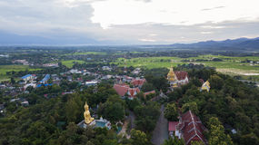 Aerial top view photo from flying drone of the Buddhist temple and fields in  the countryside Stock Image