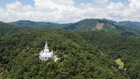 Aerial top view photo from flying drone of the Buddhist temple and fields in  the countryside Royalty Free Stock Image