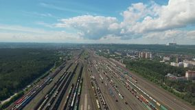 Aerial top view. Railway yard, sorting station with cargo. Aerial top view. Railway sorting station railway yard in a sunny summer day. Rails and a lot of cars stock footage