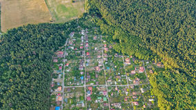 Aerial top view of residential area summer houses in forest from above, countryside real estate and dacha village in Ukraine Stock Photography