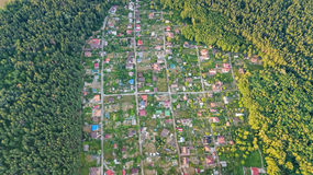 Aerial top view of residential area summer houses in forest from above, countryside real estate and dacha village in Ukraine Royalty Free Stock Images