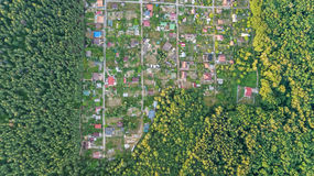 Aerial top view of residential area summer houses in forest from above, countryside real estate and dacha village in Ukraine Stock Photos