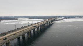 Top view on road bridge across the Dnieper River. Aerial top view on road bridge across the Dnieper River in Dnipro city at winter time. Dnepr, Dnepropetrovsk stock images