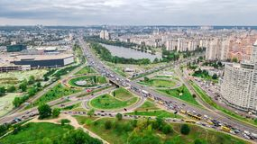 Aerial top view of road junction from above, automobile traffic and jam of many cars, transportation concept, Kiev city skyline. Obolon residential district Stock Image