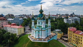 Aerial top view of Saint Andrew`s church and Andreevska street from above, cityscape of Kiev Kyiv, Ukrai Royalty Free Stock Images