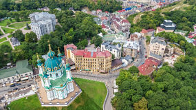 Aerial top view of Saint Andrew`s church and Andreevska street from above, cityscape of Kiev Kyiv, Ukrai Stock Images