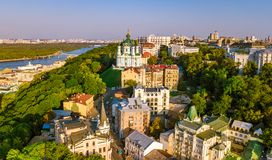 Aerial top view of Saint Andrew`s church and Andreevska street from above, cityscape of Podol district, city of Kiev Royalty Free Stock Image
