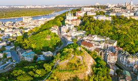 Aerial top view of Saint Andrew`s church and Andreevska street from above, cityscape of Podol district, city of Kiev Royalty Free Stock Images