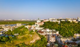 Aerial top view of Saint Andrew`s church and Andreevska street from above, cityscape of Podol district, city of Kiev Stock Image