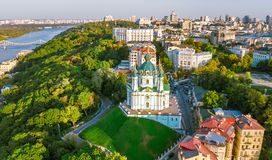 Aerial top view of Saint Andrew`s church and Andreevska street from above, cityscape of Podol district, city of Kiev Stock Photo