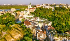 Aerial top view of Saint Andrew`s church and Andreevska street from above, cityscape of Podol district, city of Kiev Royalty Free Stock Photos