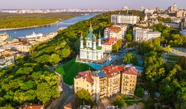 Aerial top view of Saint Andrew`s church and Andreevska street from above, cityscape of Podol district, city of Kiev Stock Photography