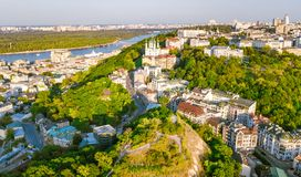 Aerial top view of Saint Andrew`s church and Andreevska street from above, cityscape of Podol district, city of Kiev Stock Photos