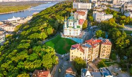 Aerial top view of Saint Andrew`s church and Andreevska street from above, cityscape of Podol district, city of Kiev Royalty Free Stock Photo
