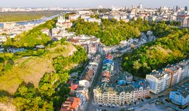 Aerial top view of Saint Andrew`s church and Andreevska street from above, cityscape of Podol district, city of Kiev Royalty Free Stock Photography