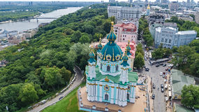 Aerial top view of Saint Andrew`s church and Andreevska street from above, cityscape of Kiev Kyiv, Ukrai Royalty Free Stock Photography