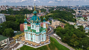 Aerial top view of Saint Andrew`s church and Andreevska street from above, cityscape of Podol district, city of Kiev, Ukrai Royalty Free Stock Photos