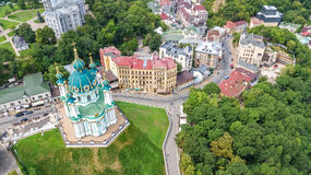 Aerial top view of Saint Andrew`s church and Andreevska street from above, cityscape of Podol district, city of Kiev, Ukrai Stock Photography