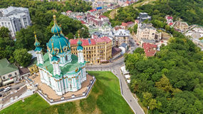 Aerial top view of Saint Andrew`s church and Andreevska street from above, Podol, city of Kiev Kyiv, Ukraine Stock Photo
