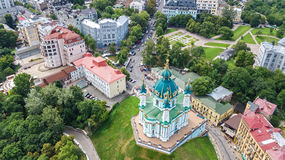 Aerial top view of Saint Andrew`s church and Andreevska street from above, Podol, city of Kiev Kyiv, Ukraine Royalty Free Stock Photo