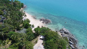 Aerial top view of sea coastline and island with palm trees. Aerial view of sea coastline and island with palm trees in Phuket, Thailand Stock Image