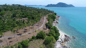 Aerial top view of sea coastline and island with palm trees Stock Photo