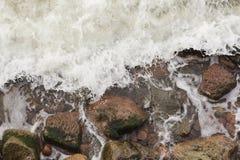Aerial top view of sea waves hitting rocks Royalty Free Stock Image
