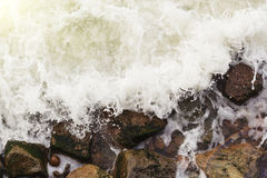 Aerial top view of sea waves hitting rocks Stock Images