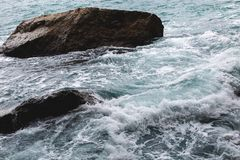 View of sea waves hitting rocks on the beach royalty free stock photography
